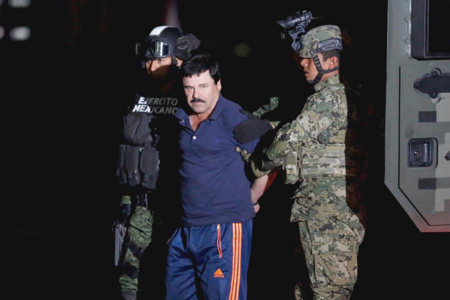Joaqu%C3%ADn+%E2%80%98El+Chapo%E2%80%99+Guzm%C3%A1n+escorted+by+Mexican+soldiers+in+Mexico+City+in+2016.+%0APhoto+Credit+to+Tomas+Bravo%2C+Reuters