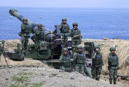 The first team of Taiwan artillerywomen poses for the press during the annual Han Kuang exercises in Pingtung County, Southern Taiwan, Thursday, May 30, 2019. (AP Photo/Chiang Ying-ying