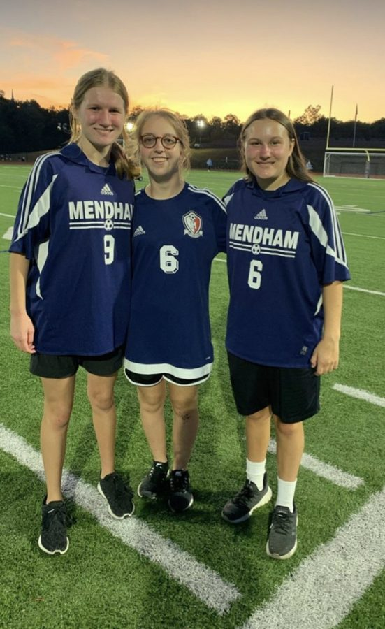 Unified Soccer Athletes post game vs. Central. On the left is Elle Purpura, in the middle is Gillian Jasper, and on the right is Peyton Purpura.