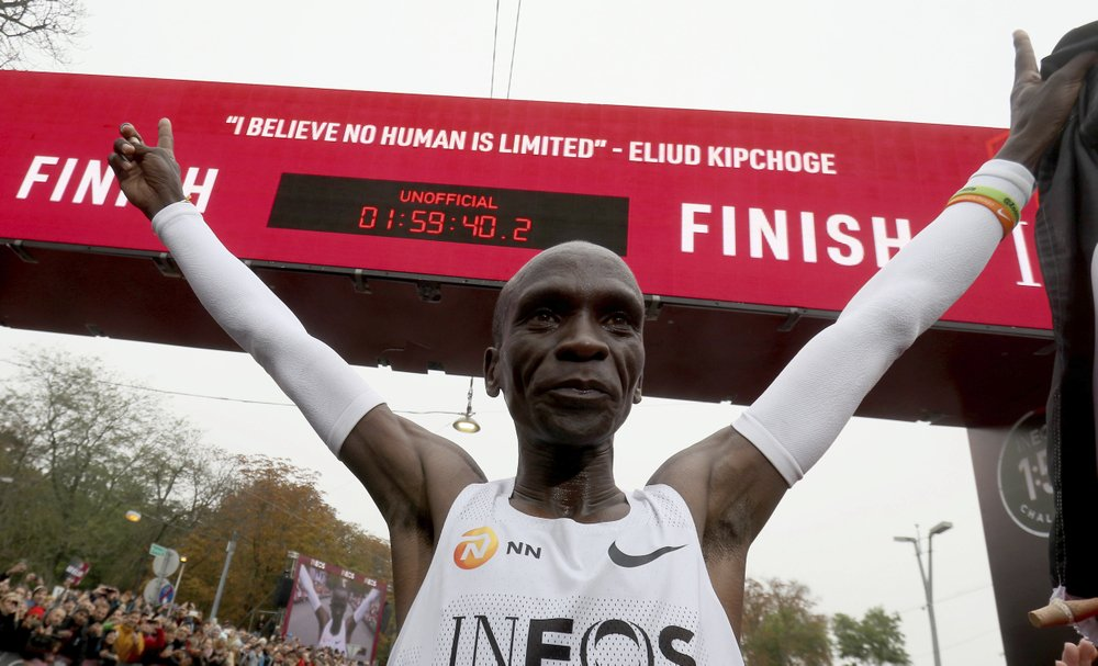 Eliud Kipchoge celebrates his record-breaking marathon under the clock.