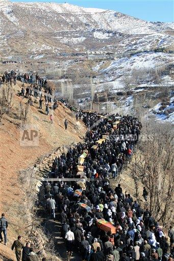 People+carry+the+coffins+of+victims+as+thousands+of+mourners+gathered+in+Gulyazi+village+at+the+border+with+Iraq%2C+southeast+Turkey%2C+Friday%2C+Dec.+30%2C+2011+for+the+funerals+of+35+Kurdish+civilians+who+were+killed+in+a+botched+raid+by+Turkish+military+jets+that+mistook+the+group+for+Kurdish+rebels+based+in+Iraq.+%28AP+Photo%29%0A%0A