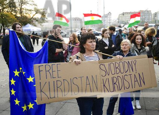 A+woman+holding+a+poster+with+writing+FREE+KURDISTAN+attends+the+demonstration+against+Turkish+invasion+of+Syria%2C+held+by+Pirate+Party+and+Kurdish+Civic+Association+in+the+Czech+Republic%2C+which+took+place+at+Palackeho+namesti%2C+Prague%2C+Czech+Republic%2C+on+Monday%2C+October+21%2C+2019.+Photo%2FRoman+Vondrous+%28CTK+via+AP+Images%29%0A%0A