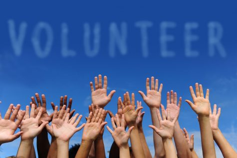 "Picture of hands in the sky, in front of the words ""volunteer"". From lawpracticetoday.org"