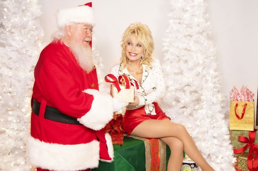 Dolly Parton in a Christmas-themed photoshoot. Image via Billboard.