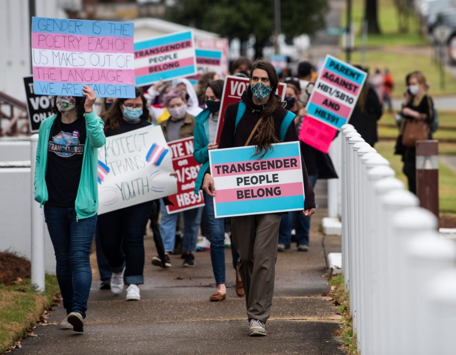 Protestors marching support of transgender rights march around the Alabama State House in Montgomery, Alabama in response to the recently passed bill regarding transgender rights. (Image via AP)