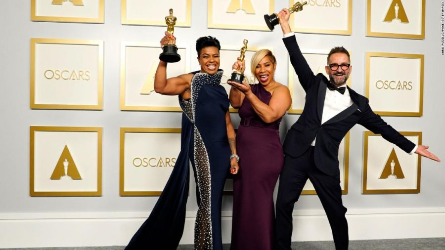 Left to right: Mia Neal, Jamika Wilson, and Sergio Lopez-Rivera, winners of the award for best makeup and hairstyling for