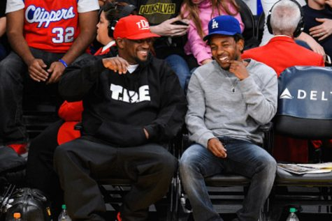Rapper Kendrick Lamar and Top Dawg Entertainment CEO Anthony Tiffith attend an NBA game together in 2015