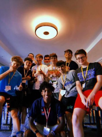 James and his friends stand for a quick photo in the hotel at the NSLC summer camp.