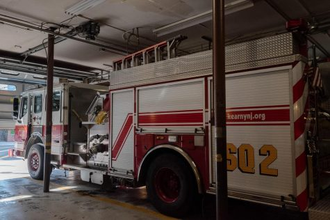 While visiting the fire department in Kearny, New Jersey, Audrey tours the building and views fire trucks.
